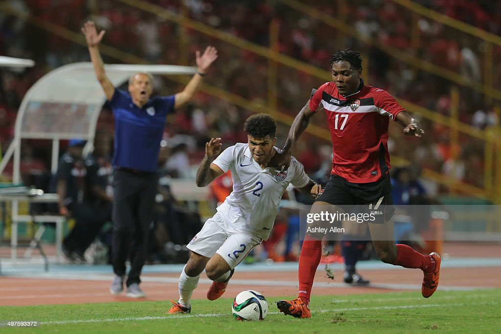 T's Mekeil Williams tackles USA's DeAndre Yedlin during a World Cup Qualifier between Trinidad and Tobago and USA as part of the FIFA World Cup...