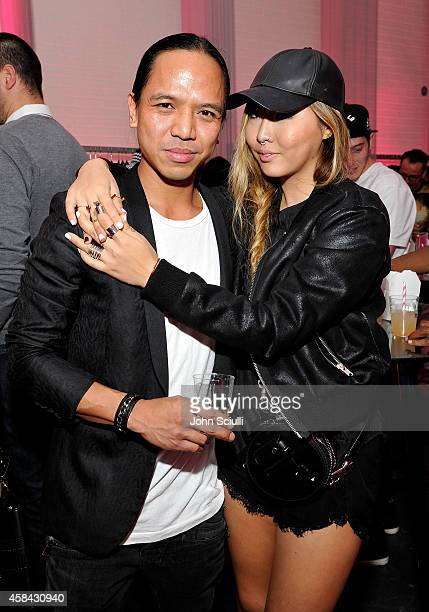 REVOLVE's Michael Mente and Dani Song attend the REVOLVE PopUp Launch Party at The Grove on November 4 2014 in Los Angeles California