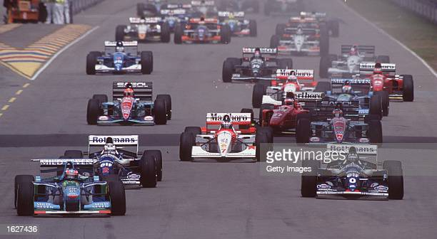 GERMANY's MICHAEL SCHUMACHER LEADS FROM DAMON HILL AT THE START OF THE AUSTRALIAN GRAND PRIX IN ADELAIDE Mandatory Credit Allsport UK
