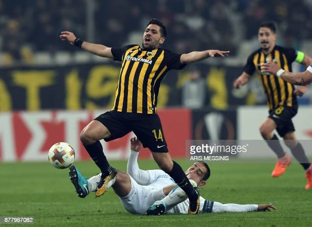 AEK's Michalis Bakasetas fights for the ball with Rijeka's Mate Males during the UEFA Europa League Group D football match between AEK Athens and...