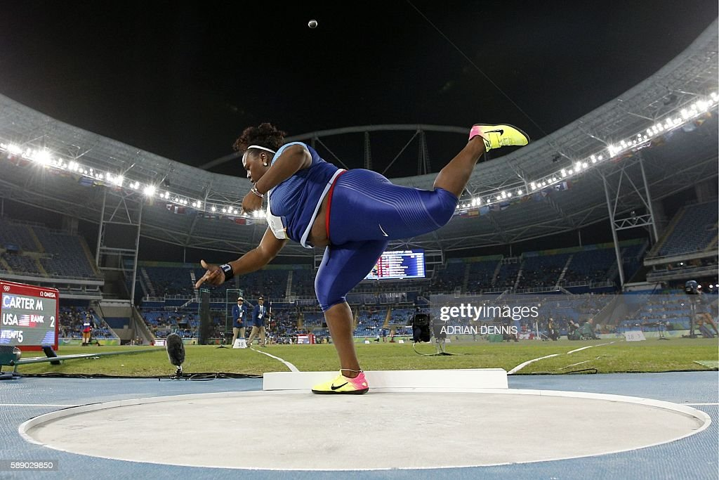 TOPSHOT - USA's Michelle Carter competes in the Women's Shot Put Final during the athletics event at the Rio 2016 Olympic Games at the Olympic Stadium in Rio de Janeiro on August 12, 2016. / AFP / Adrian DENNIS