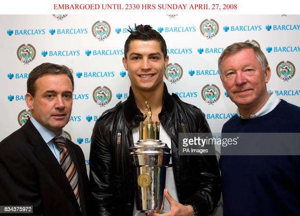 PFA's Mick McGuire Manchester United manager Alex Ferguson with PFA Players Player of the Year award winner Cristiano Ronaldo at Carrington Manchester