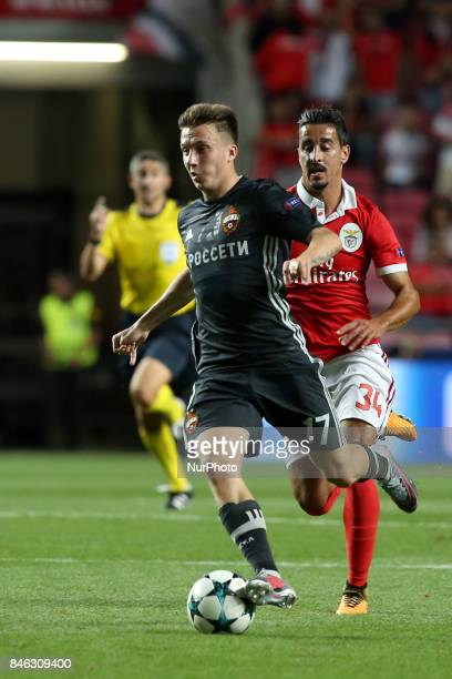 CSKA's midfielder Aleksandr Golovin vies with Benfica's Portuguese defender Andre Almeida during UEFA Champions League football match SL Benfica vs...