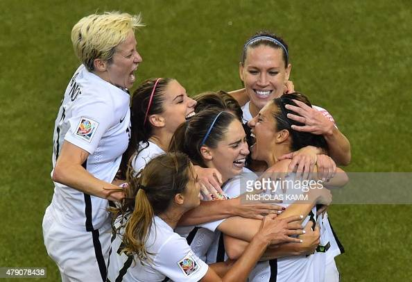 USA's midfielder and goal scorer Carli Lloyd celebrates with teammates during their 2015 FIFA Women's World Cup semifinal match against Germany at...
