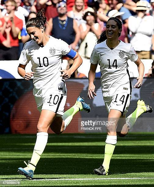 USA's midfielder Carli Lloyd celebrates her goal with teammate Morgan Brian during the final football match between USA and Japan during their 2015...