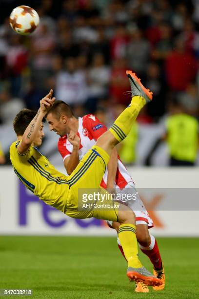 BATE's midfielder Evgeni Berezkin vies with Crvena zvezda's midfielder Nenad Krsticic during the UEFA Europa League match between Crvena Zvezda and...