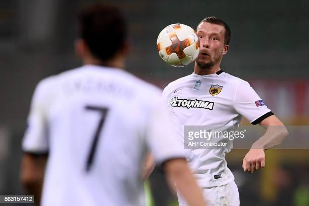 AEK's midfielder Jakon Johansson from Sweden eyes the ball during the UEFA Europa League football match AC Milan vs AEK Athens at the 'San Siro...