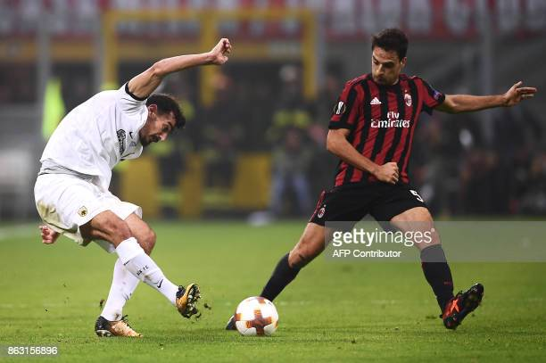 AEK's midfielder Lazaros Christodoulopoulos from Greece fights for the ball with AC Milan's midfielder Giacomo Bonaventura from Italy during the UEFA...