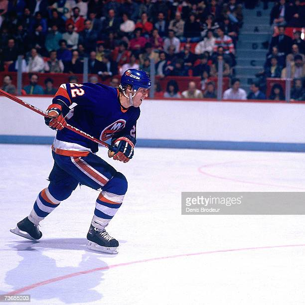 MONTREAL 1980's Mike Bossy of the New York Islanders skates up the ice against the Montreal Canadiens