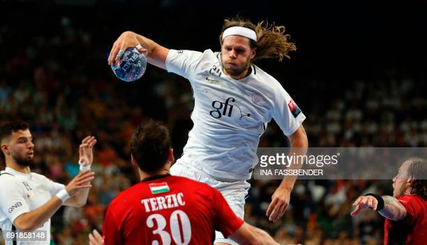 PSG's Mikkel Hansen and Veszprem's Mirsad Terzic vie for the ball during the Handball EHF Champions League final Four semi final match between...