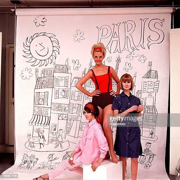 1960's Models stand against a studio based backdrop of a sketch of Paris