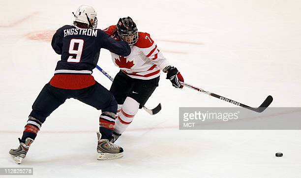 USA's Molly Engstrom checks Canada's Cherie Piper in the Women's Gold Medal Hockey game during the 2010 Winter Olympics in Vancouver British Columbia...