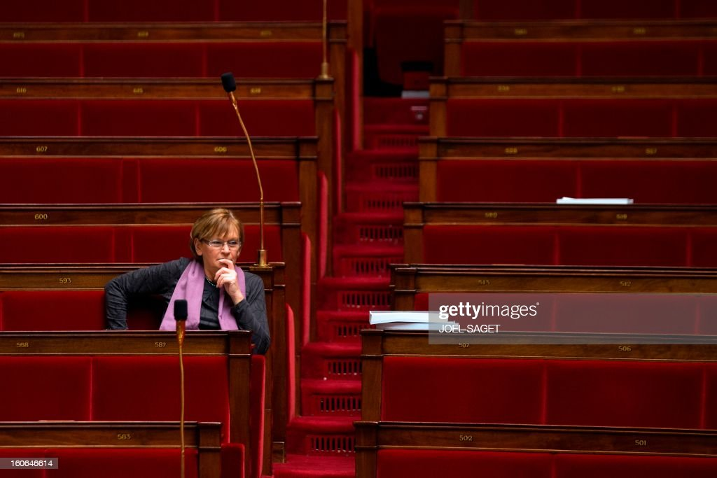 PCF (French Communist Party)'s MP Marie-George Buffet takes part in the debate to allow gay couples to get married and adopt children on February 4, 2013 at the National Assembly in Paris. Two days before, Members of Parliament voted 249-97 in favour of Article One of the draft law, which redefines marriage as being a contract between two people rather than necessarily between a man and a woman. AFP PHOTO JOEL SAGET
