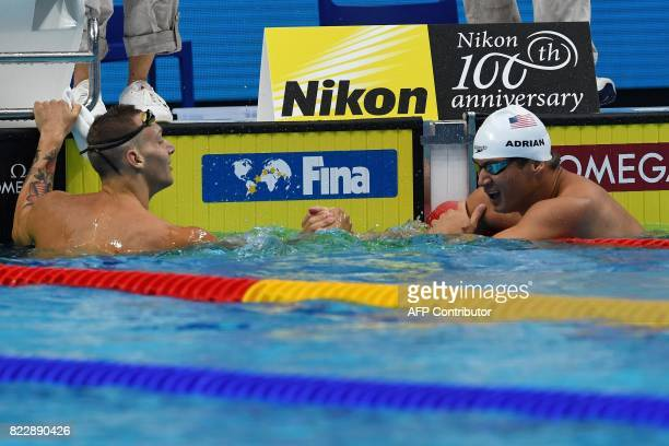 USA's Nathan Adrian shakes hands with US Caeleb Remel Dressel after a men's 100m freestyle heat during the swimming competition at the 2017 FINA...