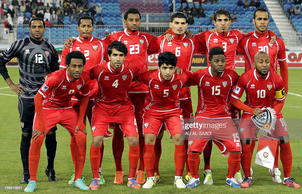 UAE's national football team players pose for a group picture before their 21st Gulf Cup football match against Oman in the Bahraini capital Manama on January 11, 2013. AFP PHOTO/ALI AL-SAADI