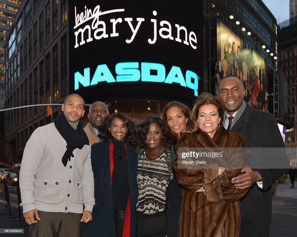 BET's Networks' 'Being Mary Jane' cast members (L-R) Aaron Spears, Richard Roundtree, Margaret Avery, Raven Goodwin, Mara Brock Akil, Lisa Vidal and Richard Brooks visit NASDAQ MarketSite on January 6, 2014 in New York City.