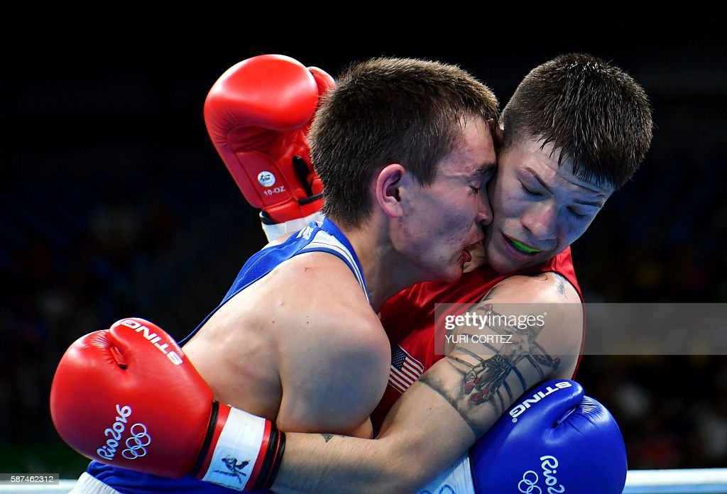 TOPSHOT USA's Nico Miguel Hernandez is stranded by Russia's Vasilii Egorov during the Men's Light Fly match at the Rio 2016 Olympic Games at the...