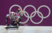 USA's Noelle PikusPace jumps on her sled for her second qualifying run in the women's skeleton event on Thursday Feb 13 at the Winter Olympic in...