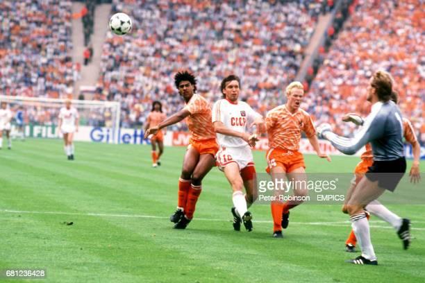USSR's Oleg Protasov is denied by Holland's Frank Rijkaard Ronald Koeman and Hans van Breukelen