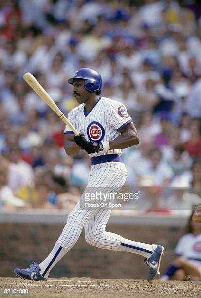 CHICAGO IL CIRCA 1980's Outfielder Andre Dawson of the Chicago Cubs swings and misses a pitch during a late circa 1980's Major League Baseball game...