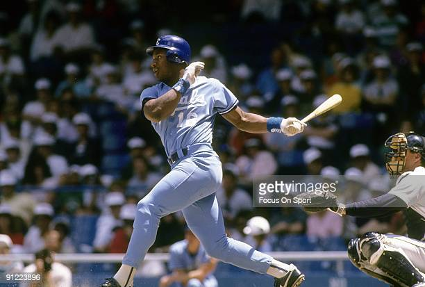 CIRCA 1980's Outfielder Bo Jackson of the Kansas City Royals swings and watches the flight of his ball during a Major League baseball game circa late...
