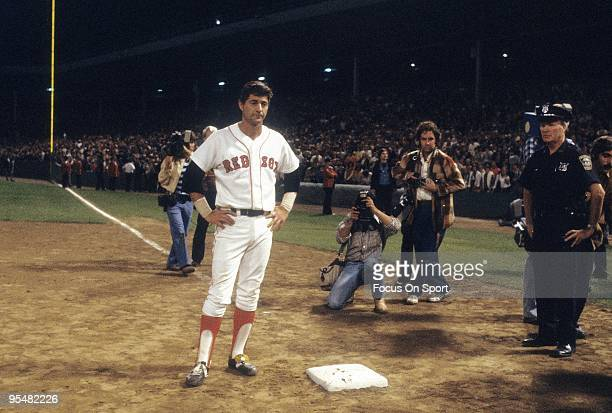 BOSTON MA CIRCA 1980's Outfielder Carl Yastrzemski of the Boston Red Sox on a night he's being honored stands at first base before a MLB baseball...
