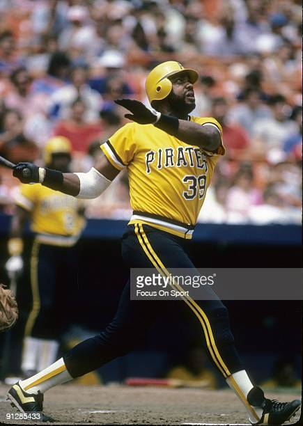 CIRCA 1970's Outfielder Dave Parker of the Pittsburgh Pirates swings and watches the flight of his ball during a circa 1970's Major League Baseball...