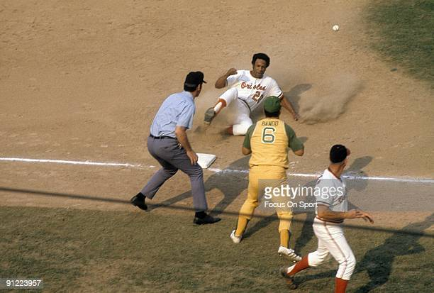 BALTIMORE MD CIRCA 1970's Outfielder Frank Robinson of the Baltimore Orioles in action sliding safe into third base against the Oakland Athletics...