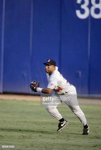 CIRCA 1990's Outfielder Kirby Puckett of the Minnesota Twins races toward the ball from center field during a MLB baseball game circa early 1990's...