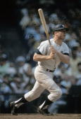 BRONX NY CIRCA 1960's Outfielder Mickey Mantle of the New York Yankees watches the flight of his ball as he follows through on a swing during a circa...