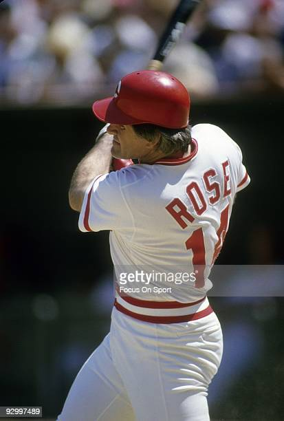CINCINNATI OH CIRCA 1970's Outfielder Pete Rose of the Cincinnati Reds swings at a pitch and watches the flight of his ball during a MLB baseball...