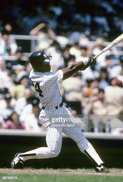 BRONX NY CIRCA 1980's Outfielder Rickey Henderson of the New York Yankees swings and watches the flight of his ball during an mid circa 1980's Major...