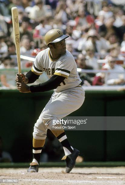 CIRCA 1970's Outfielder Roberto Clemente of Pittsburgh Pirates is ready to hit waiting on the pitch during a MLB baseball game circa early 1970's...