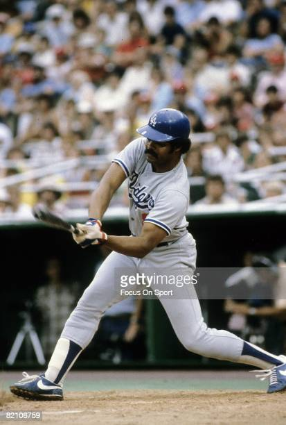CIRCA 1970's Outfielder/First Baseman Reggie Smith of the Los Angeles Dodgers swings and misses the pitch during a late circa 1970's Major League...