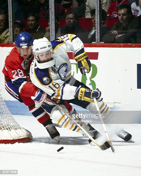MONTREAL 1990's Pat LaFontaine of the Buffalo Sabres races for the puck against the Montreal Canadiens in the 1990's at the Montreal Forum in...