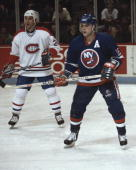 MONTREAL 1980's Pat LaFontaine of the New York Islanders looks for the puck against Chris Chelios of the Montreal Canadiens in the 1980's at the...