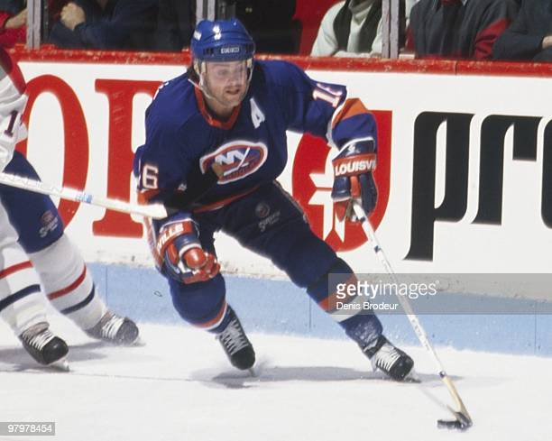 MONTREAL 1980's Pat LaFontaine of the New York Islanders skates with the puck against the Montreal Canadiens in the 1980's at the Montreal Forum in...