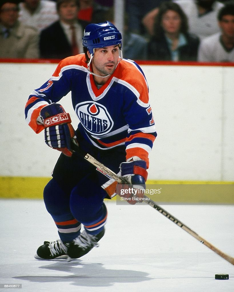 BOSTON MA 1980's Paul Coffey of the Edmonton Oilers skates up ice with puck against the Boston Bruins at the Boston Garden in Boston