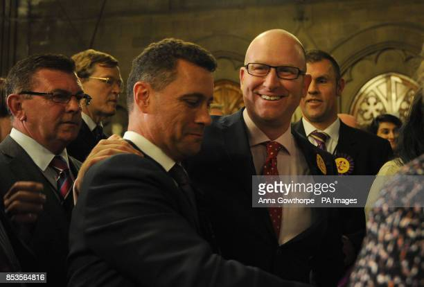 UKIP's Paul Nuttall celebrates with other party members during the European Parliamentary elections count at Manchester Town Hall Manchester
