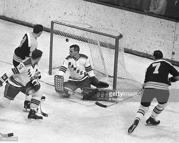 NEW YORK 1960's Phil Esposito and Ken Hodge of the Boston Bruins beat Ed Giacomin of the New York Rangers during a game in the 1960's at Madison...