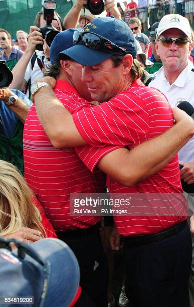 USA's Phil Mickelson and captain Paul Azinger celebrate their victory during Singles on Day Three at Valhalla Golf Club Louisville USA