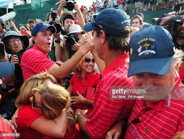 USA's Phil Mickelson celebrates their victory with captain Paul Azinger during Singles on Day Three at Valhalla Golf Club Louisville USA