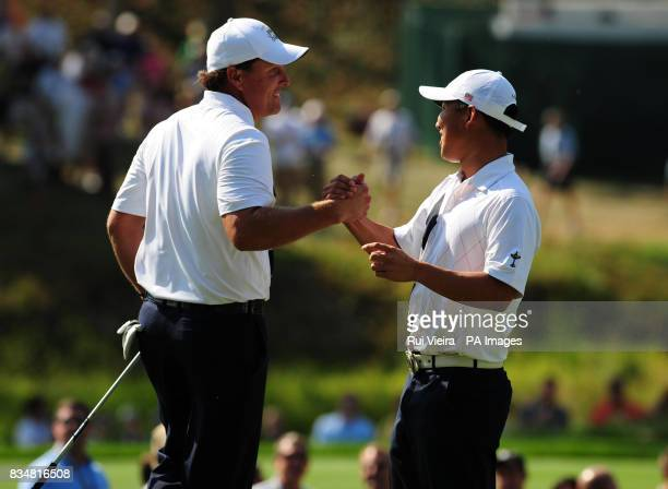 USA's Phil Mickelson left celebrates with Anthony Kim on the 14th green during The Foursomes on Day One at Valhalla Golf Club Louisville USA