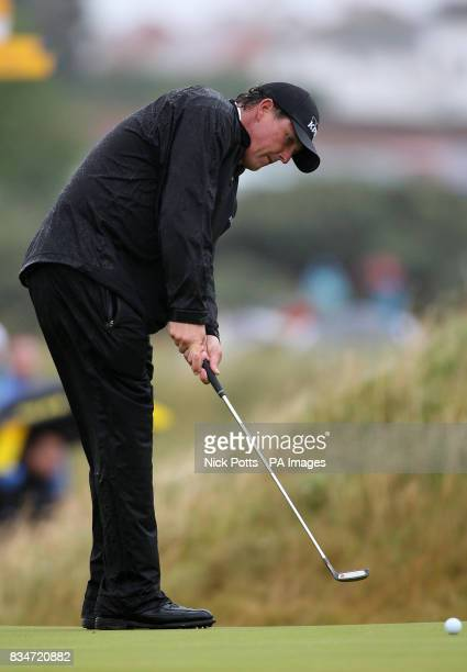 USA's Phil Mickelson putts on the 9th green during Round One of the Open Championship at the Royal Birkdale Golf Club Southport