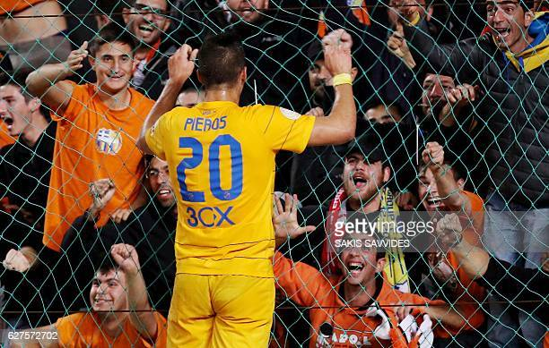 FC's Pieros Sotiriou celebrates with fans after scoring during the 1st league football match between APOEL FC and Omonia on December 3 at Nicosia's...