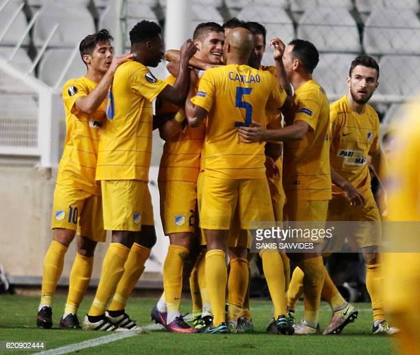 APOEL's Pieros Sotiriou celebrates with his teammates after scoring a goal during their UEFA Europa League football match between Cyprus' APOEL of...
