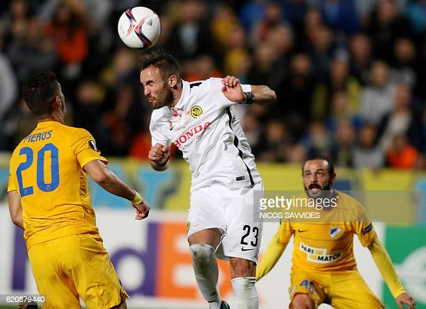 APOEL's Pieros Sotiriou vies with Young Boys' Scott Sutter during their UEFA Europa League football match between Cyprus' APOEL of Nicosia and...