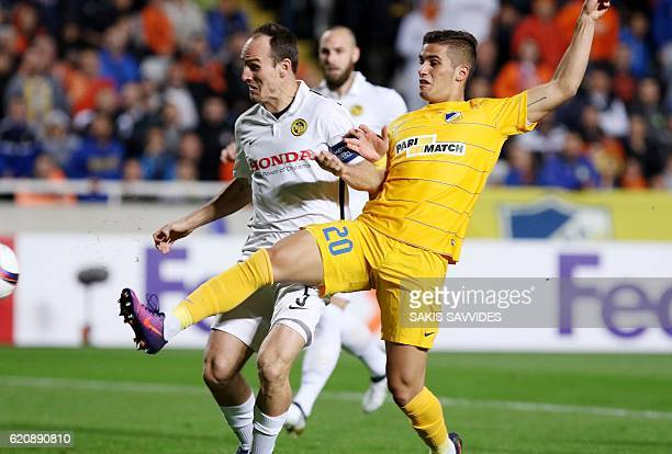 APOEL's Pieros Sotiriou vies with Young Boys' Steve von Bergen during their UEFA Europa League football match between Cyprus' APOEL of Nicosia and...