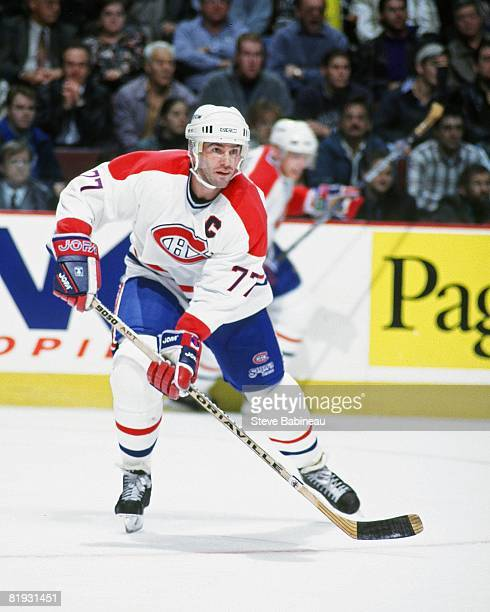 MONTREAL 1990's Pierre Turgeon of the Montreal Canadiens looks to make pass in game against the Boston Bruins at the Bell Center