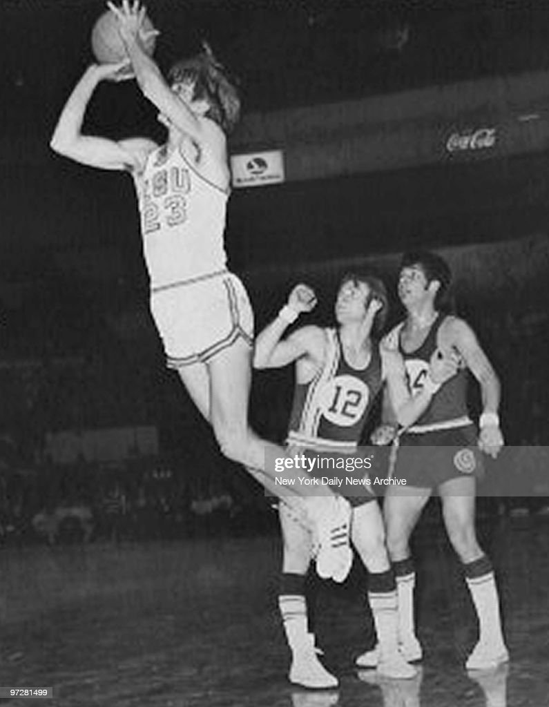 LSU s Pistol Pete Maravich forces shot over Geor own s Don